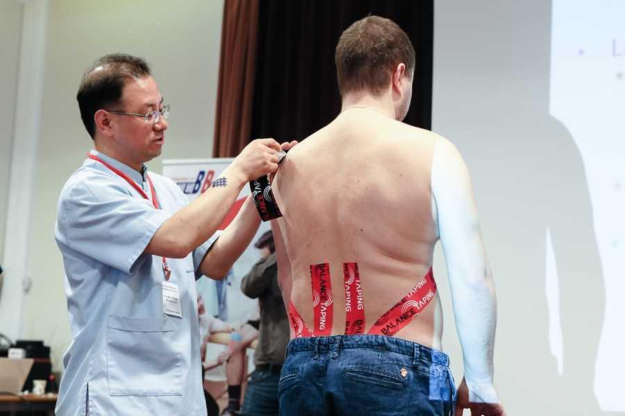 Тейпирование спины при болезненных ощущениях